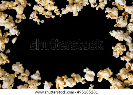 pop corn isolated on black with space for text