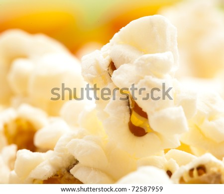 pop corn on a bowl, extreme closeup photo - stock photo