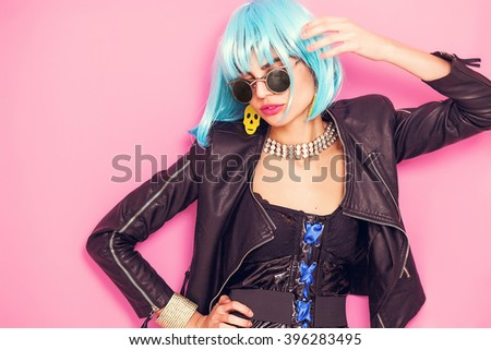 Pop girl portrait wearing weird accessories and posing