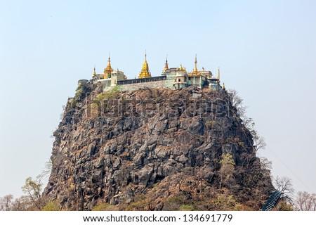 Popa Taungkalat monastery atop an outcrop of Mount Popa volcano, Myanmar. - stock photo