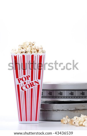 popcorn and film canister isolated on white