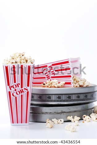 popcorn and film canister isolated on white - stock photo