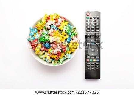 Popcorn and remote control - stock photo