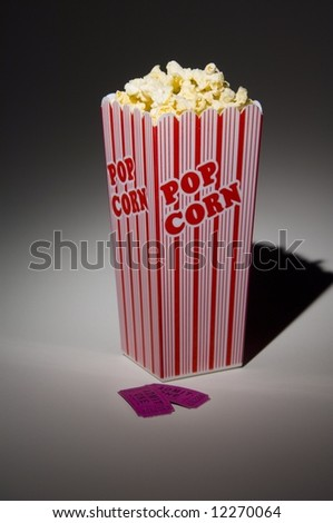 Popcorn and ticket - stock photo