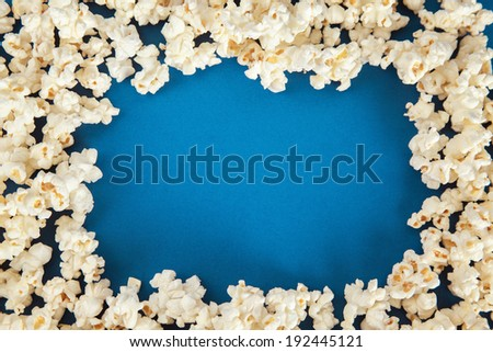 Popcorn border on blue background.