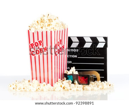 popcorn box with clapper board and 3d movie glasses on white background