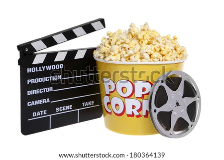Popcorn bucket with cutout and movie reel on white background - stock photo