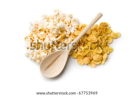 Popcorn, cornflakes and spoon isolated on white - stock photo