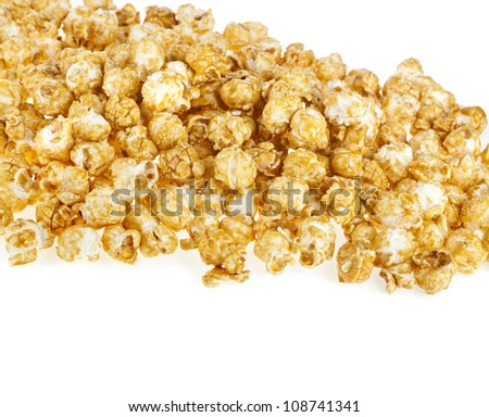 popcorn covered caramel isolated on white - stock photo