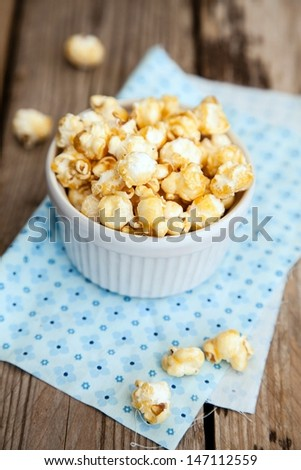 Popcorn covered with caramel on wooden table  - stock photo