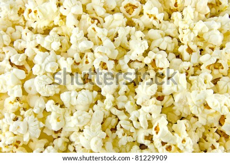 Popcorn delicious maize useful as a background. - stock photo