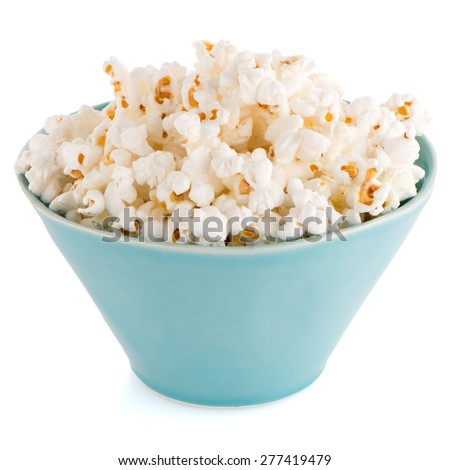 Popcorn in a blue bowl on a white background - stock photo
