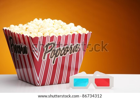 Popcorn in a container with 3D glasses.  3D cinema concept - stock photo