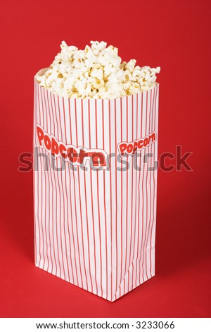 Popcorn in a red and white popcorn bag
