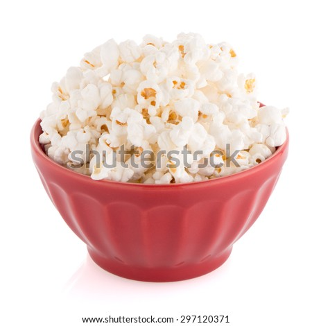 Popcorn in a red bowl on a white background - stock photo