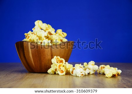 Popcorn in a wooden bowl - stock photo