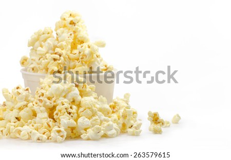 Popcorn in bowl isolate on white - stock photo