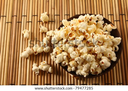 popcorn in bowl over mat - stock photo