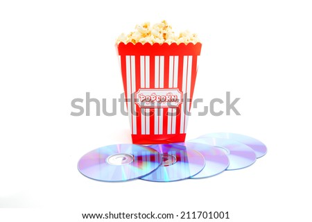 popcorn in box with DVD disk on white background  - stock photo