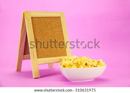 popcorn in heart shape bowl and board - stock photo