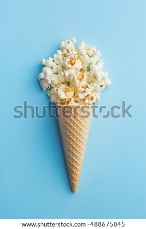 Popcorn in ice cream cones. Top view.