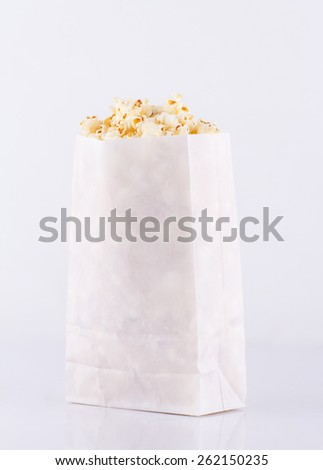 Popcorn in paper bag isolated on white background  - stock photo