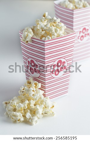 Popcorn in popcorn bag isolated on white background - stock photo