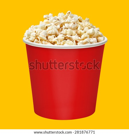 Popcorn in red bucket on yellow background