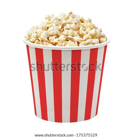 Popcorn in striped bucket on white background - stock photo