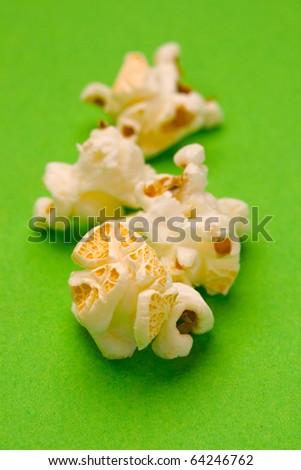 Popcorn isolated on green - stock photo