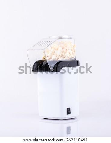 Popcorn making machine isolated on white  - stock photo