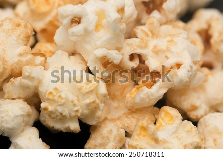 popcorn on a black background - stock photo