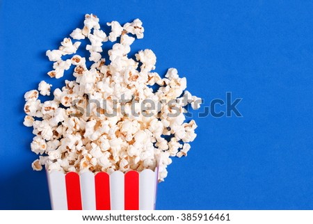 popcorn on blue - stock photo