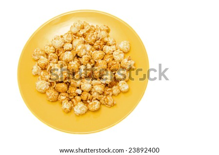 popcorn on yellow plate isolated on white - stock photo