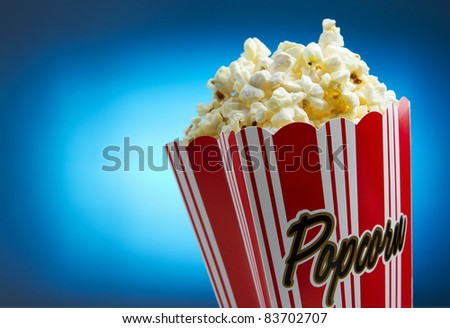 Popcorn over blue background, movie concept - stock photo