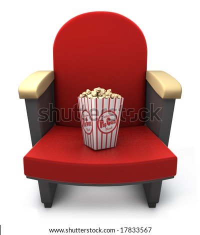Popcorn package on theater seat - stock photo