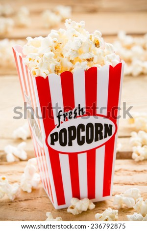 Popcorn - This is a shot of popcorn in a box ready to be eaten. Shot with a shallow depth of field. - stock photo