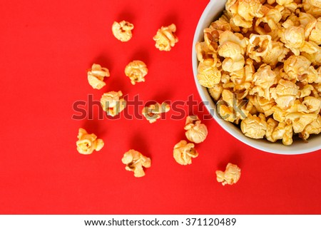 popcorn white bowl on red background - stock photo