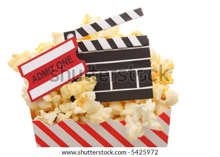 Popcorn with an admit ticket and movie clapper in a popcorn bag isolated on white background - stock photo