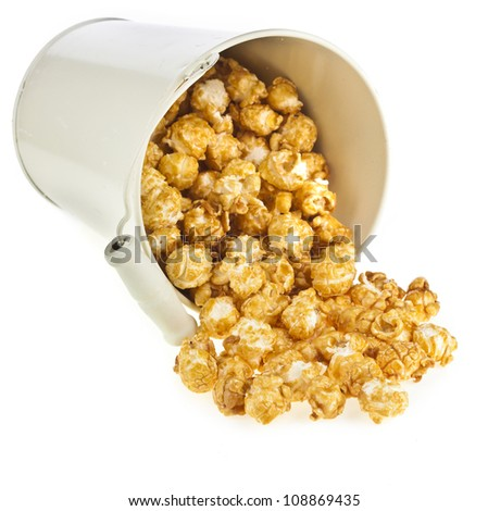 popcorn with caramel  in a bucket box isolated on white - stock photo