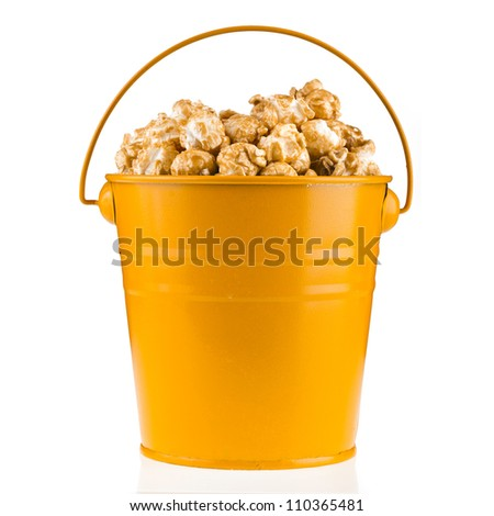 popcorn with caramel in a bucket isolated on white - stock photo