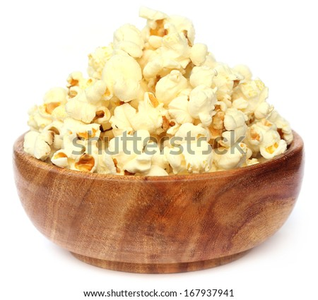 Popcorns on wooden bowl over white background - stock photo