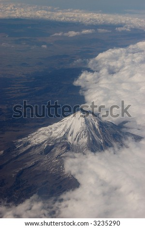 Popocatépetl Volcano Image taken from airplane in Mexico - stock photo