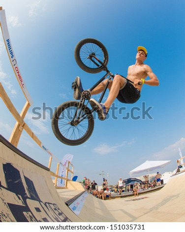 "POPOVKA, UKRAINE - AUGUST 14. Racer Anton Evstifeev on competition of BMX ""Z-Games Spirit of action 2013"" on august 14, 2013 in Popovka, Ukraine - stock photo"