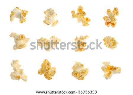 Popped kernels of pop corn snack isolated over white background