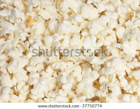 Popped popcorn, ready for eating - stock photo