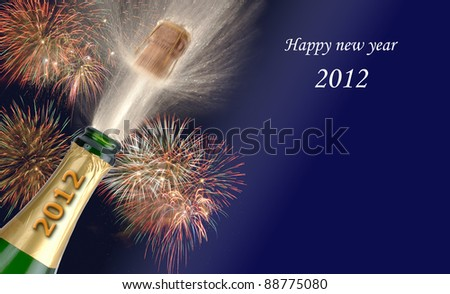 popping champagne at new year 2012 - stock photo