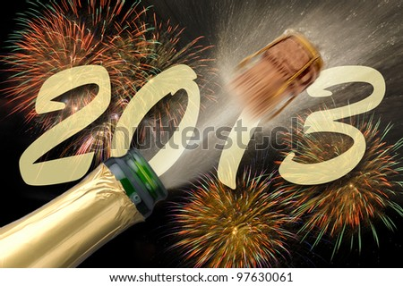 popping champagne at new year firework 2013 - stock photo