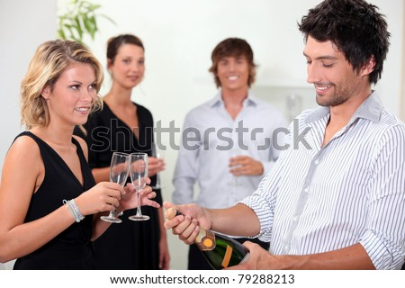 Popping the champagne - stock photo
