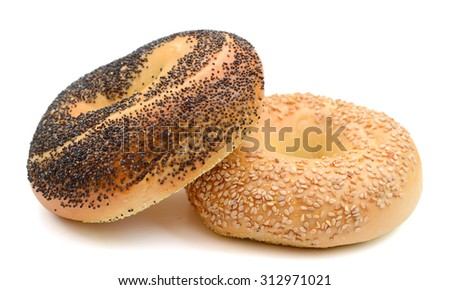 poppy and sesame seed bagels on white background  - stock photo